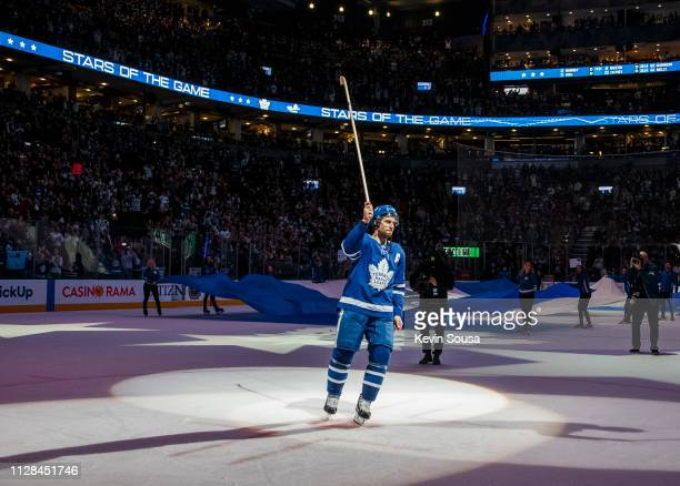 John Tavares of the Toronto Maple Leafs salutes the crowd after receiving a star of the game after defeating the Buffalo Sabres at the Scotiabank...