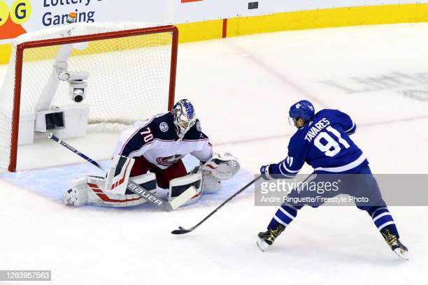 John Tavares of the Toronto Maple Leafs scores a goal past Joonas Korpisalo of the Columbus Blue Jackets during the third period in Game Two of the...