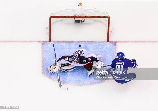 John Tavares of the Toronto Maple Leafs scores against Joonas Korpisalo of the Columbus Blue Jackets during the third period in Game Two of the...