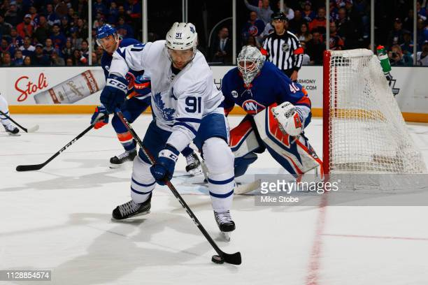 John Tavares of the Toronto Maple Leafs skates against Robin Lehner of the New York Islanders at NYCB Live's Nassau Coliseum on February 28 2019 in...