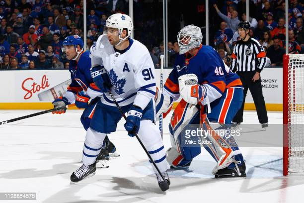 John Tavares of the Toronto Maple Leafs skates against Robin Lehner of the New York Islanders at NYCB Live's Nassau Coliseum on February 28, 2019 in...