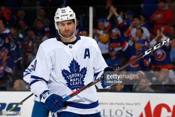 John Tavares of the Toronto Maple Leafs skates against the New York Islanders at NYCB Live's Nassau Coliseum on February 28 2019 in Uniondale New...