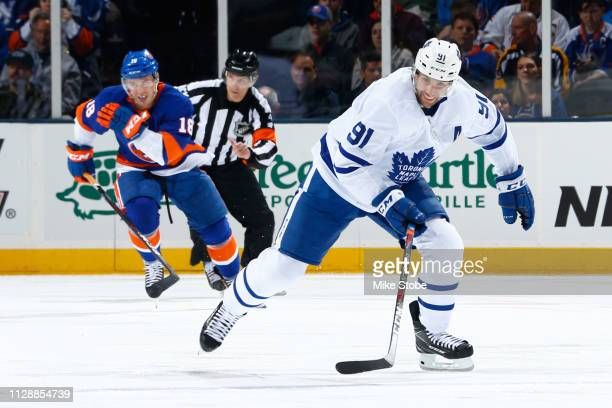 John Tavares of the Toronto Maple Leafs skates against the New York Islanders at NYCB Live's Nassau Coliseum on February 28, 2019 in Uniondale, New...