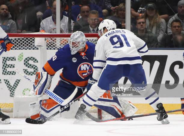 John Tavares of the Toronto Maple Leafs skates in on Robin Lehner of the New York Islanders at NYCB Live's Nassau Coliseum on April 01 2019 in...