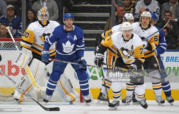 John Tavares of the Toronto Maple Leafs stands in between Matt Murray and Evgeni Malkin of the Pittsburgh Penguins during an NHL game at Scotiabank...