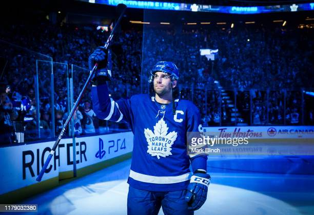John Tavares of the Toronto Maple Leafs takes the ice for the first time as the Maple Leafs captain during opening night introductions ahead of...