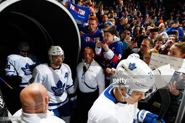 John Tavares of the Toronto Maple Leafs walks out onto the ice to warmup prior to the game against the New York Islanders at NYCB Live's Nassau...