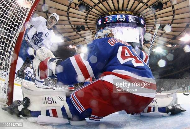 John Tavares of the Toronto Maple Leafs watches a shot by Mitchell Marner get past Alexandar Georgiev of the New York Rangers at 2:50 of the second...