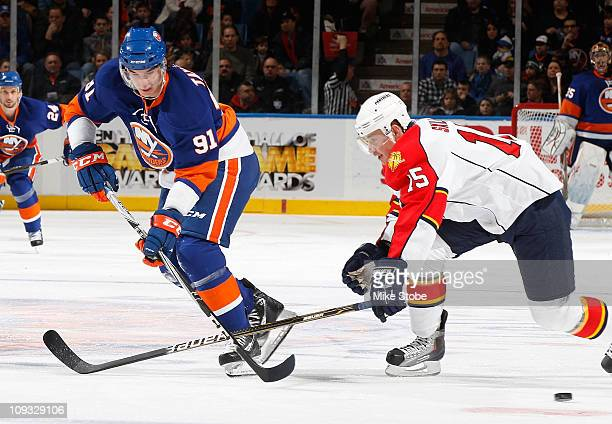 John Tavares the New York Islanders and Jack Skille of the Florida Panthers skate for position on February 21 2011 at Nassau Coliseum in Uniondale...