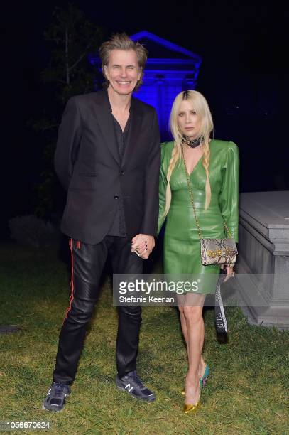 John Taylor and Gela NashTaylor attend Gucci Guilty Launch Party at Hollywood Forever on November 2 2018 in Hollywood California
