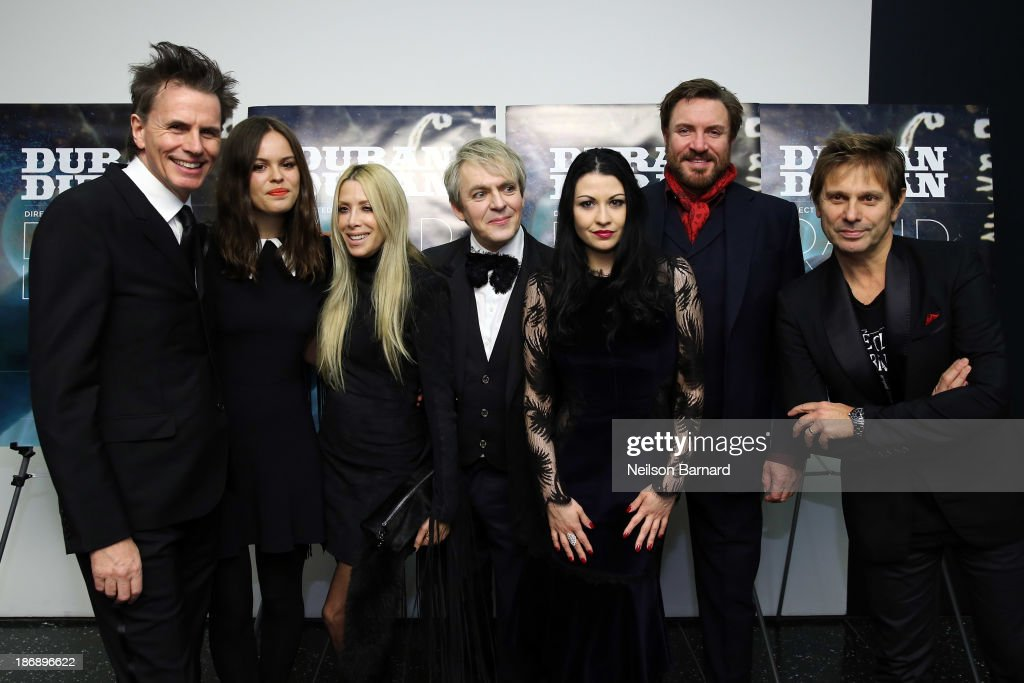 John Taylor, Atlanta De Cadenet Taylor, Gela Nash Taylor,Nick Rhodes, Nefer Suvio, Simon Le Bon and Roger Taylor of Duran Duran attend the 'Duran Duran: Unstaged' premiere during the 6th Annual MoMA Contenders Series at Museum of Modern Art on November 4, 2013 in New York City.