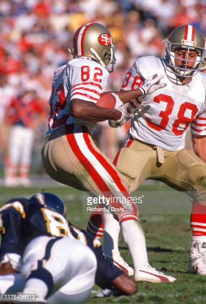PR John Taylor heads up field after catching a punt as a Chargers defender misses the tackle San Francisco 49ers 48 vs San Diego Chargers 10 at Jack...