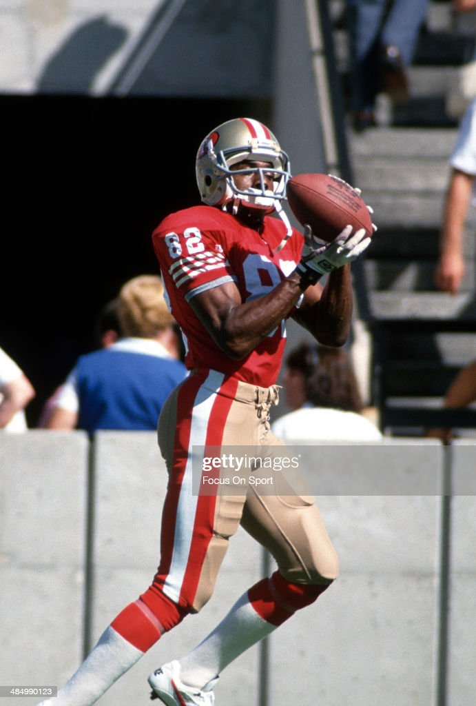 51d8733988a John Taylor of the San Francisco 49ers catches a pass in pre-game ...