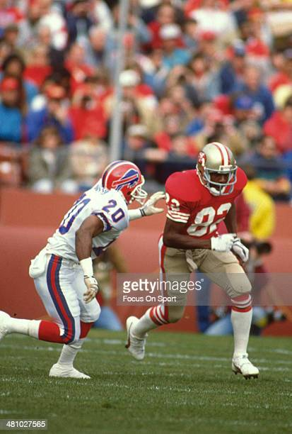 John Taylor of the San Francisco 49ers in action against Mickey Sutton of the Buffalo Bills during an NFL football game December 17 1989 at...