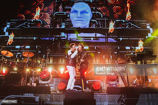 John Taylor, Simon Le Bon and Nick Rhodes of Duran Duran perform on stage at Manchester Arena on November 27, 2015 in Manchester, England.