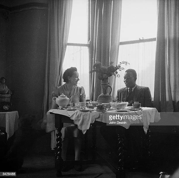 John Teah Brown who is originally from Sierra Leone dining with his wife Mary Brown in their Manchester home Original Publication Picture Post 3024...