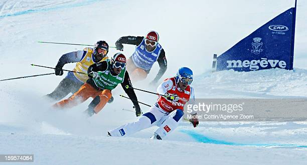 John Teller of the USA Jouni Pellinen of Finland during the FIS Freestyle Ski World Cup Men's and Women's Ski Cross on January 16 2013 in Megeve...