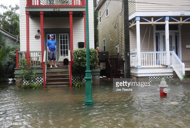 John Terrezza looks out at a flooded street in front of his home as Hurricane Sally passes through the area on September 16, 2020 in Pensacola,...