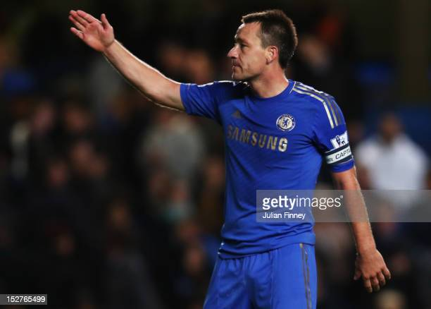 John Terry acknowledges the fans after the Capital One Cup third round match between Chelsea and Wolverhampton Wanderers at Stamford Bridge on...