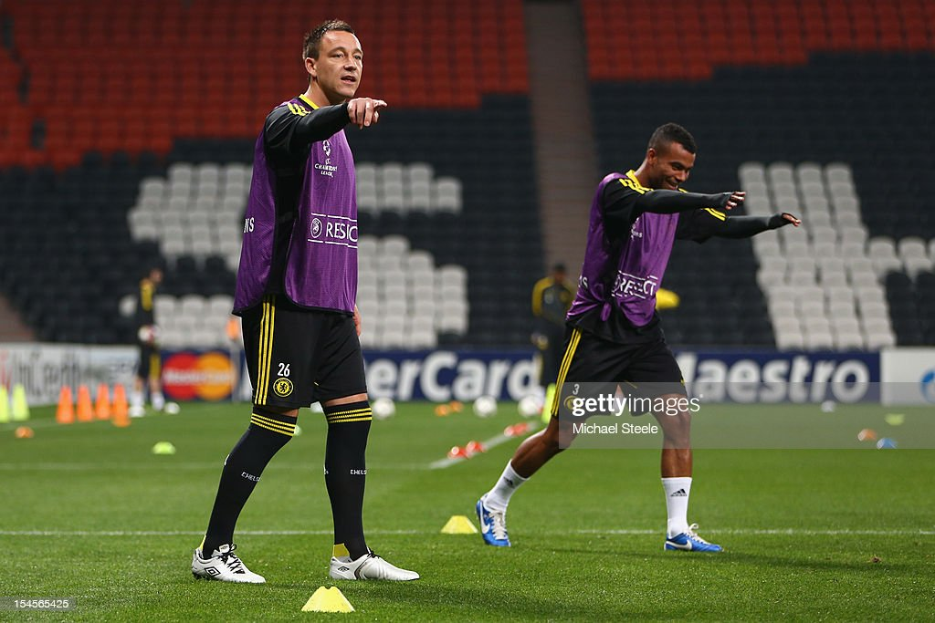 John Terry (L) alongside Ashley Cole (R) during the Chelsea Training session ahead of the UEFA Champions League Group E match between Shakhtar Donetsk and Chelsea at Donbass Arena on October 22, 2012 in Donetsk, Ukraine.