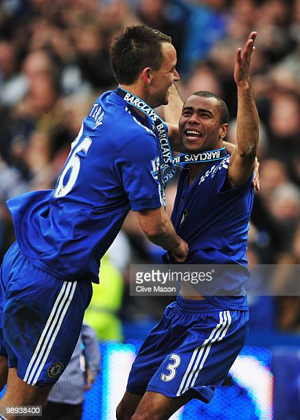 John Terry and Ashley Cole of Chelsea celebrate as they win the title after the Barclays Premier League match between Chelsea and Wigan Athletic at...