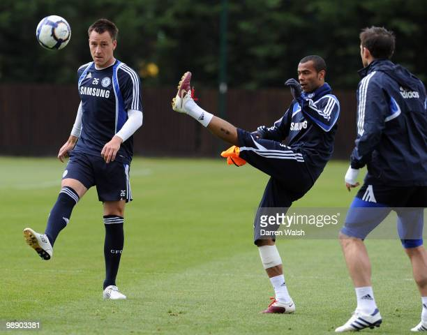 John Terry and Ashley Cole of Chelsea during a training session at the Cobham Training Ground on May 7, 2010 in Cobham, England.