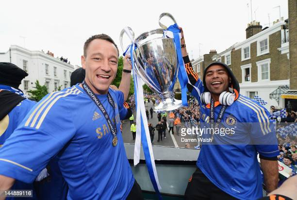 John Terry and Ashley Cole pose with the Champions League trophy during the Chelsea victory parade following their UEFA Champions League and FA Cup...