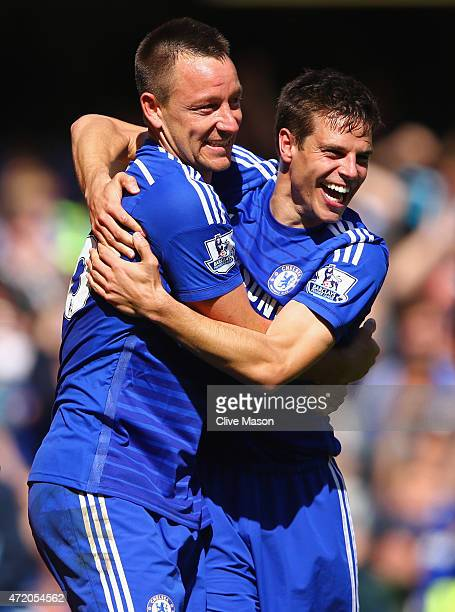 John Terry and Cesar Azpilicueta celebrate winning the Premier League title after the Barclays Premier League match between Chelsea and Crystal...