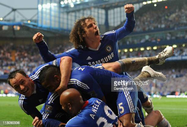 John Terry and David Luiz of Chelsea celebrate with team mates Fernando Torres's first goal for Chelsea during the Barclays Premier League match...