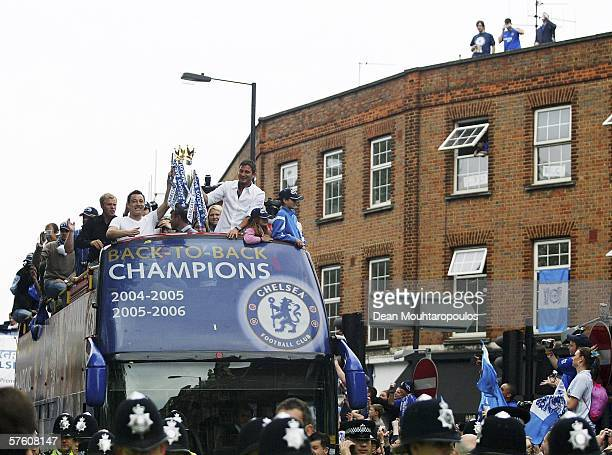 John Terry and Frank Lampard lead the celebrations as they show the Premiership Trophy to the fans on the opentopped bus parade of the Barclays...