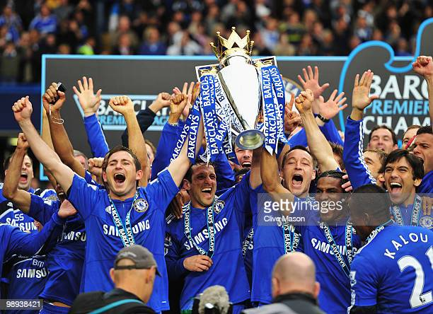 John Terry and Frank Lampard of Chelse lift the trophy after the Barclays Premier League match between Chelsea and Wigan Athletic at Stamford Bridge...