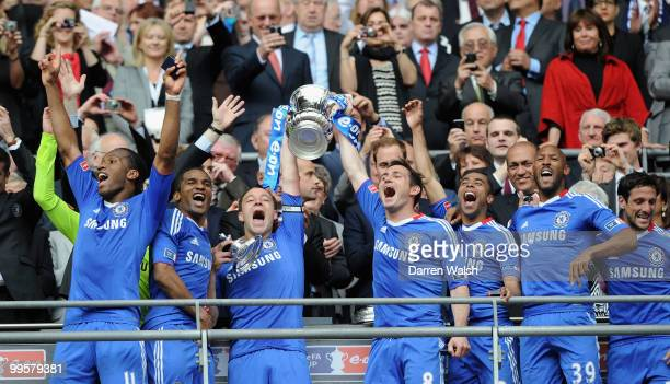 John Terry and Frank Lampard of Chelsea lifts the trophy with team mates following their victory at the end of the FA Cup sponsored by EON Final...
