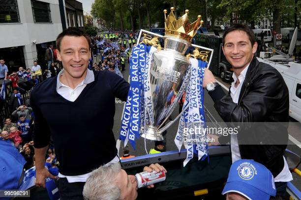 John Terry and Frank Lampard of Chelsea pose with the Premier League trophyduring the Chelsea Football Club Victory Parade on May 16 2010 in London...