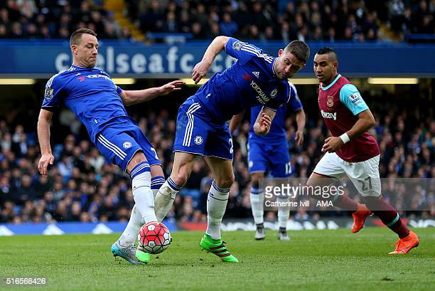John Terry and Gary Cahill of Chelsea both go for the ball during the Barclays Premier League match between Chelsea and West Ham United at Stamford...