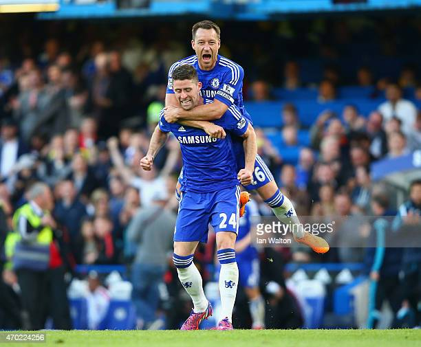 John Terry and Gary Cahill of Chelsea celebrate after the Barclays Premier League match between Chelsea and Manchester United at Stamford Bridge on...
