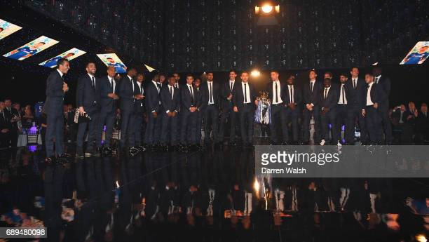 John Terry and Gary Cahill of Chelsea hold the Premier League trophy with team mates on stage during the Chelsea Player of the Year awards at...
