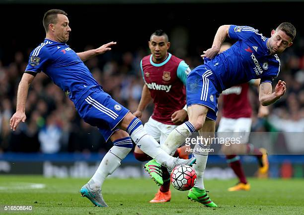 John Terry and Gary Cahill of Chelsea in action during the Barclays Premier League match between Chelsea and West Ham United at Stamford Bridge on...