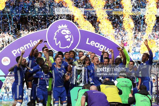 John Terry and Gary Cahill of Chelsea lift the Premier League trophy as their teammates celebrate at the end of the Premier League match between...
