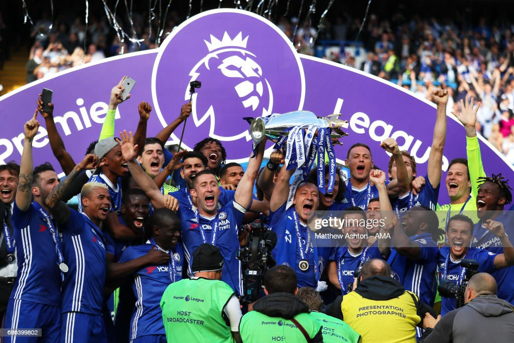 John Terry and Gary Cahill of Chelsea lift the Premier League trophy as their team-mates celebrate at the end of the Premier League match between Chelsea and Sunderland at Stamford Bridge on May 21, 2017 in London, England.