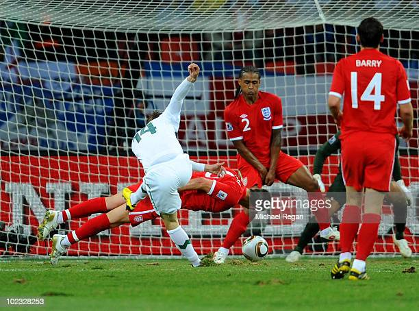 John Terry and Glen Johnson of England defend a shot by Zlatko Dedic of Slovenia during the 2010 FIFA World Cup South Africa Group C match between...