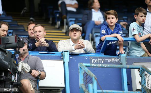 John Terry and his brother Paul Terry watch on from the stands during the Premier League match between Chelsea FC and Leicester City at Stamford...