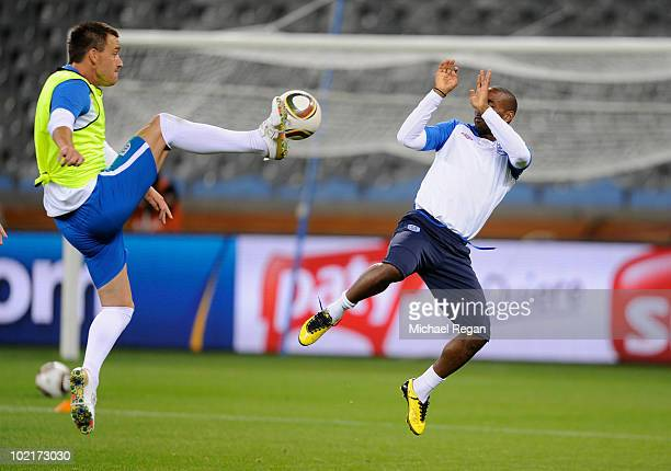 John Terry and Jermain Defoe in action during the England training session at the Green Point Stadium on June 17 2010 in Cape Town South Africa