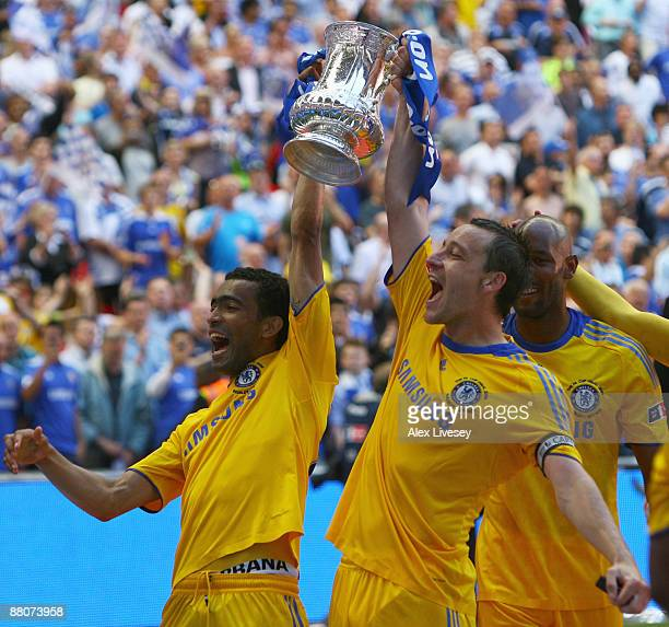 John Terry and Jose Bosingwa of Chelsea celebrate with the trophy after the FA Cup sponsored by EON Final match between Chelsea and Everton at...