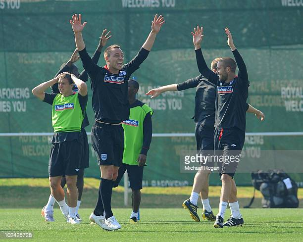 John Terry and Matthew Upson celebrate a goal as Stephen Warnock looks on during the England training session at the Royal Bafokeng Sports Campus on...