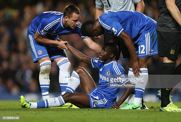 John Terry and Mikel John Obi pull Ramires of Chelsea up from the pitch