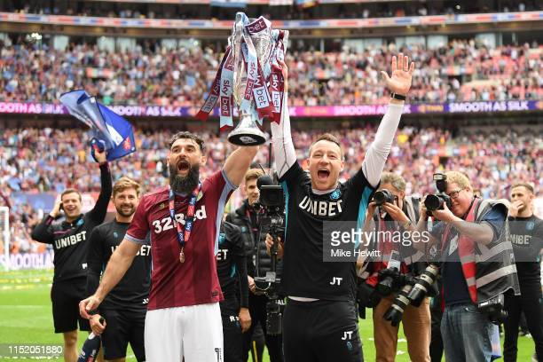 John Terry and Mile Jedinak of Aston Villa celebrates after the Sky Bet Championship Play-off Final match between Aston Villa and Derby County at...