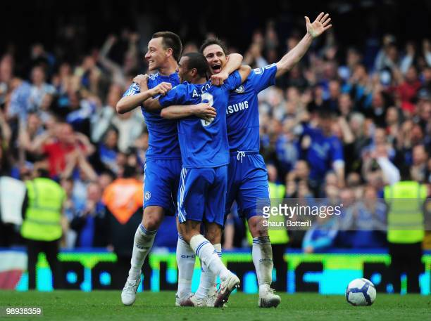 John Terry Ashley Cole and Frank Lampard of Chelsea celebrate as they win the title after the Barclays Premier League match between Chelsea and Wigan...