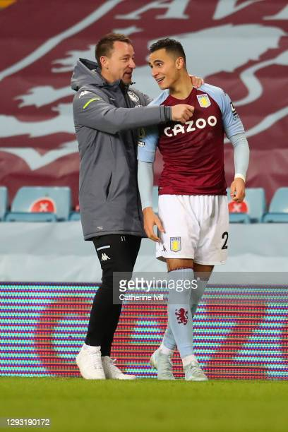 John Terry, Assistant Coach of Aston Villa embraces Anwar El Ghazi of Aston Villa following their sides victory in the Premier League match between...
