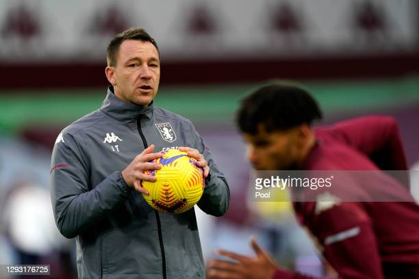 John Terry, Assistant Coach of Aston Villa looks on during the warm up prior to the Premier League match between Aston Villa and Crystal Palace at...