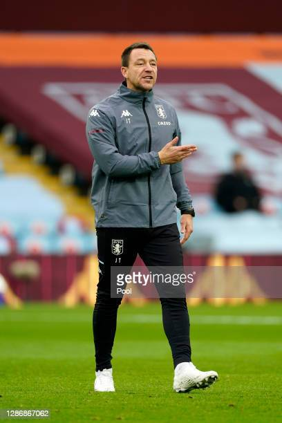 John Terry, Assistant Coach of Aston Villa looks on prior to the Premier League match between Aston Villa and Brighton & Hove Albion at Villa Park on...